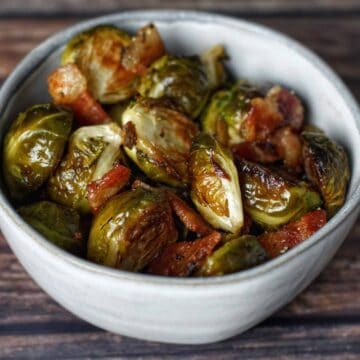 Roasted Brussels sprouts with bacon served in a small bowl.