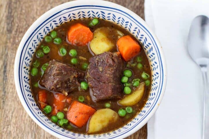 Overhead view of a bowl of beef stew.