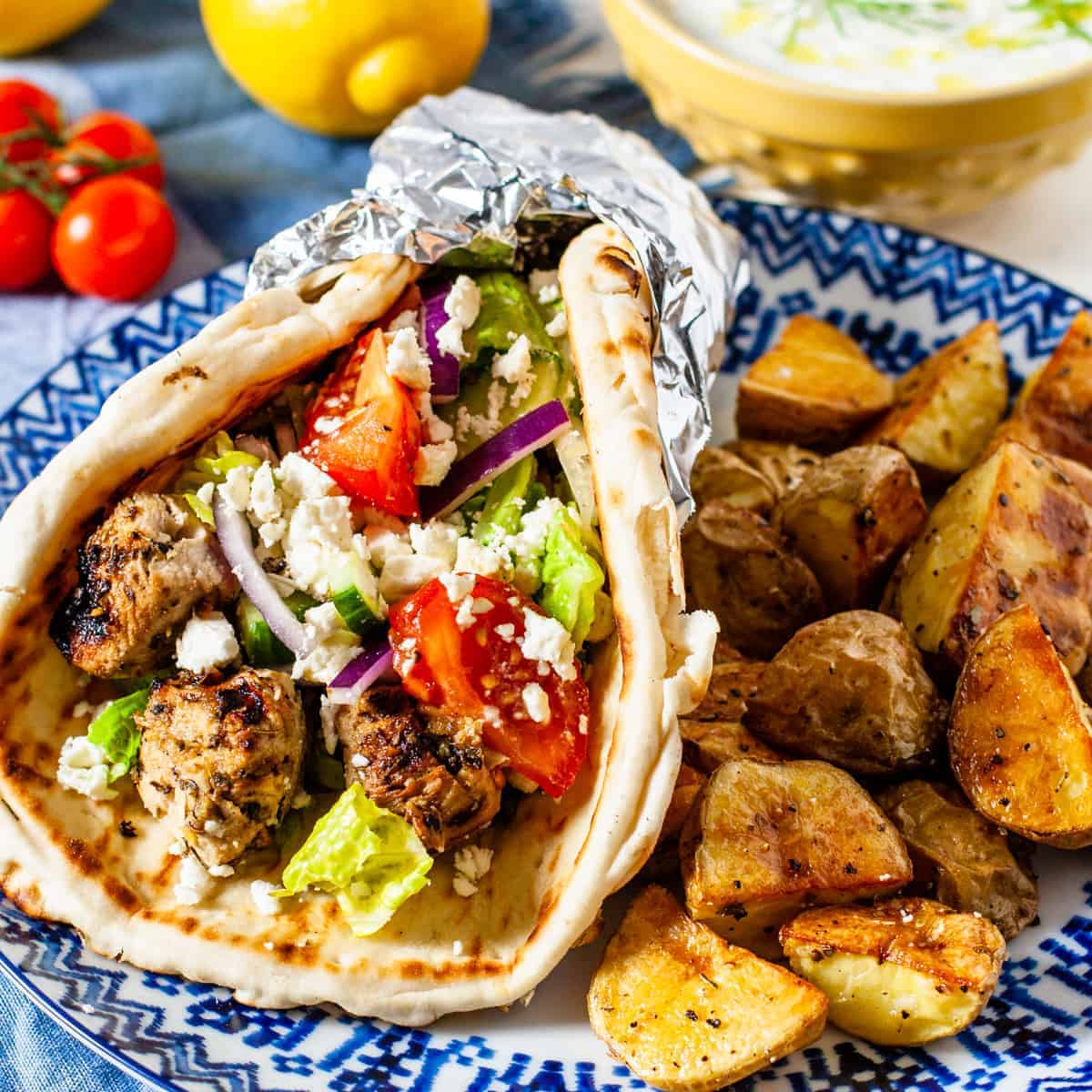 chicken souvlaki pita wrap served with roasted potatoes