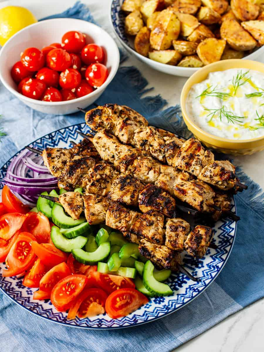 chicken souvlaki on platter with veggies