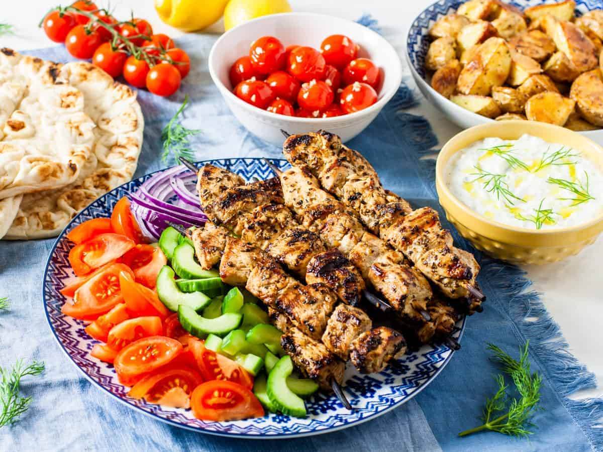 chicken souvlaki with side dishes