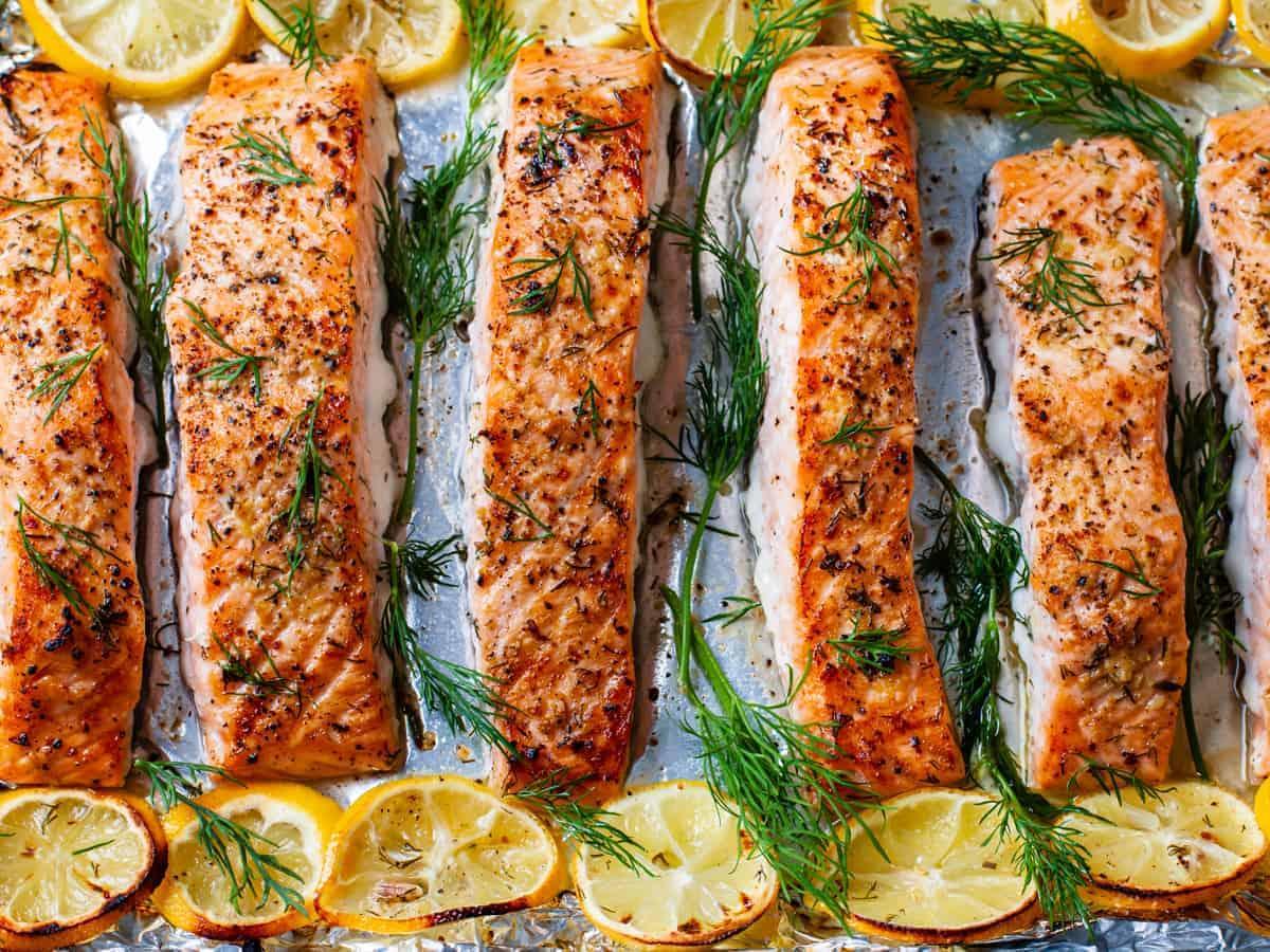 Overhead view of the lemon dill salmon on sheet pan.
