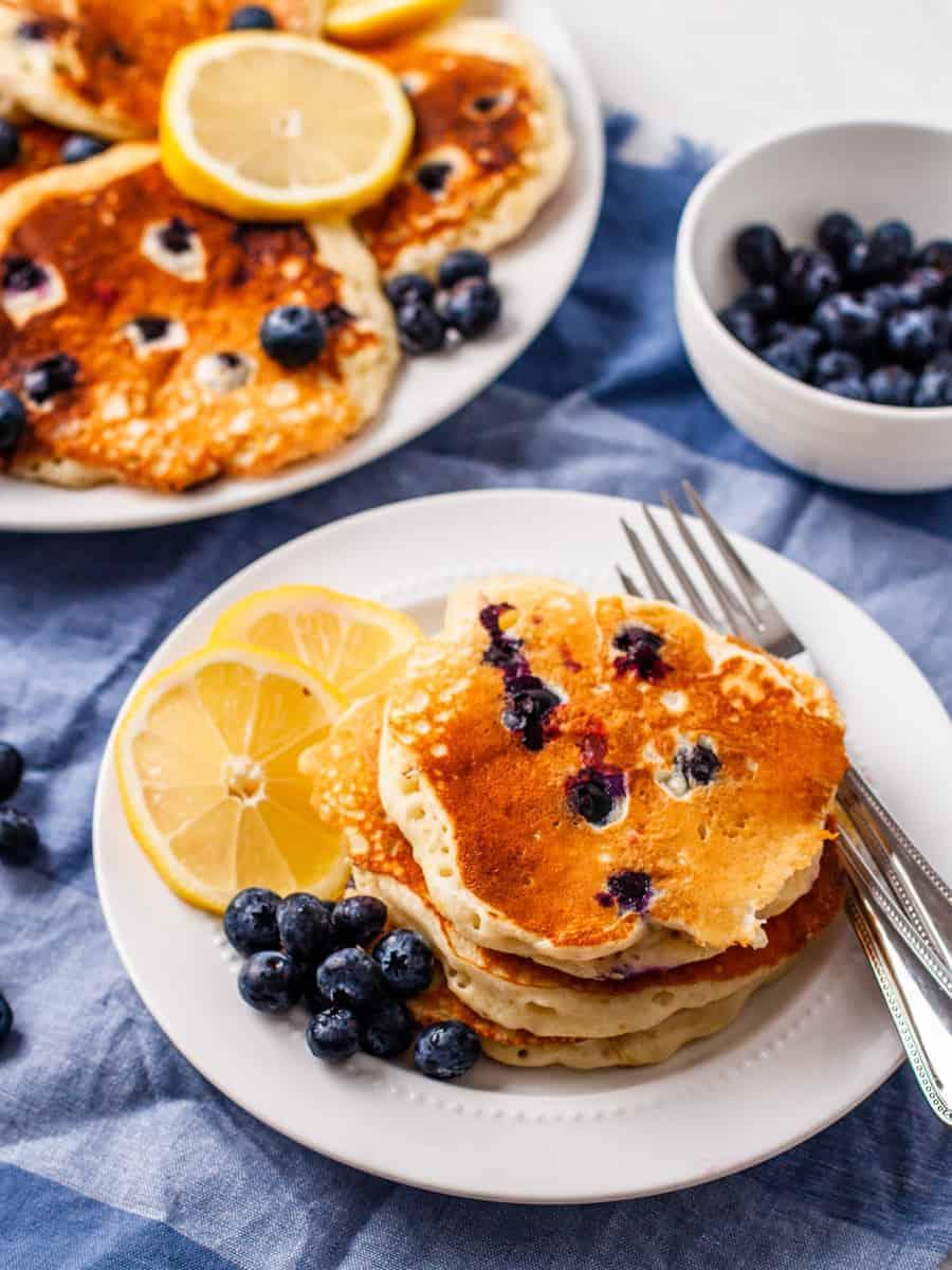Lemon Blueberry pancakes shown with fresh blueberries