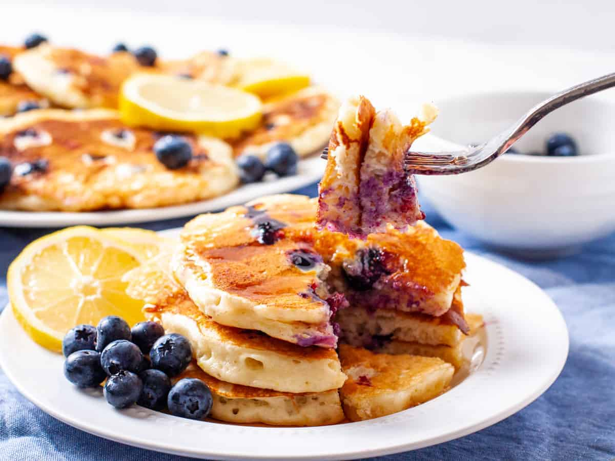 A delicious bite of fluffy lemon and blueberry pancakes