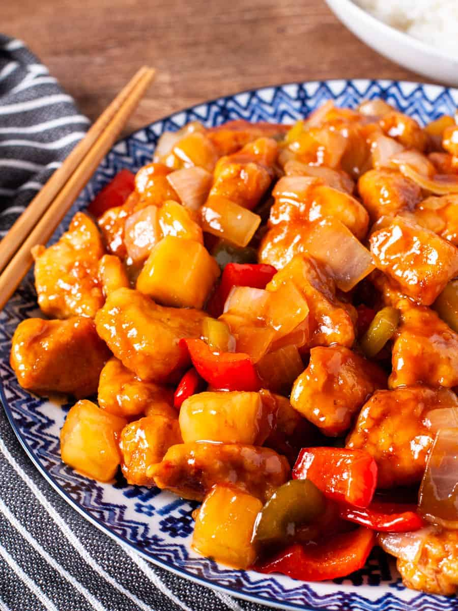 A large platter of crispy sweet and sour chicken served wioth steamed