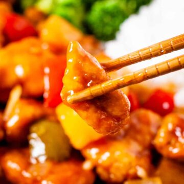 Close up shot of a bite of sweet and sour chicken