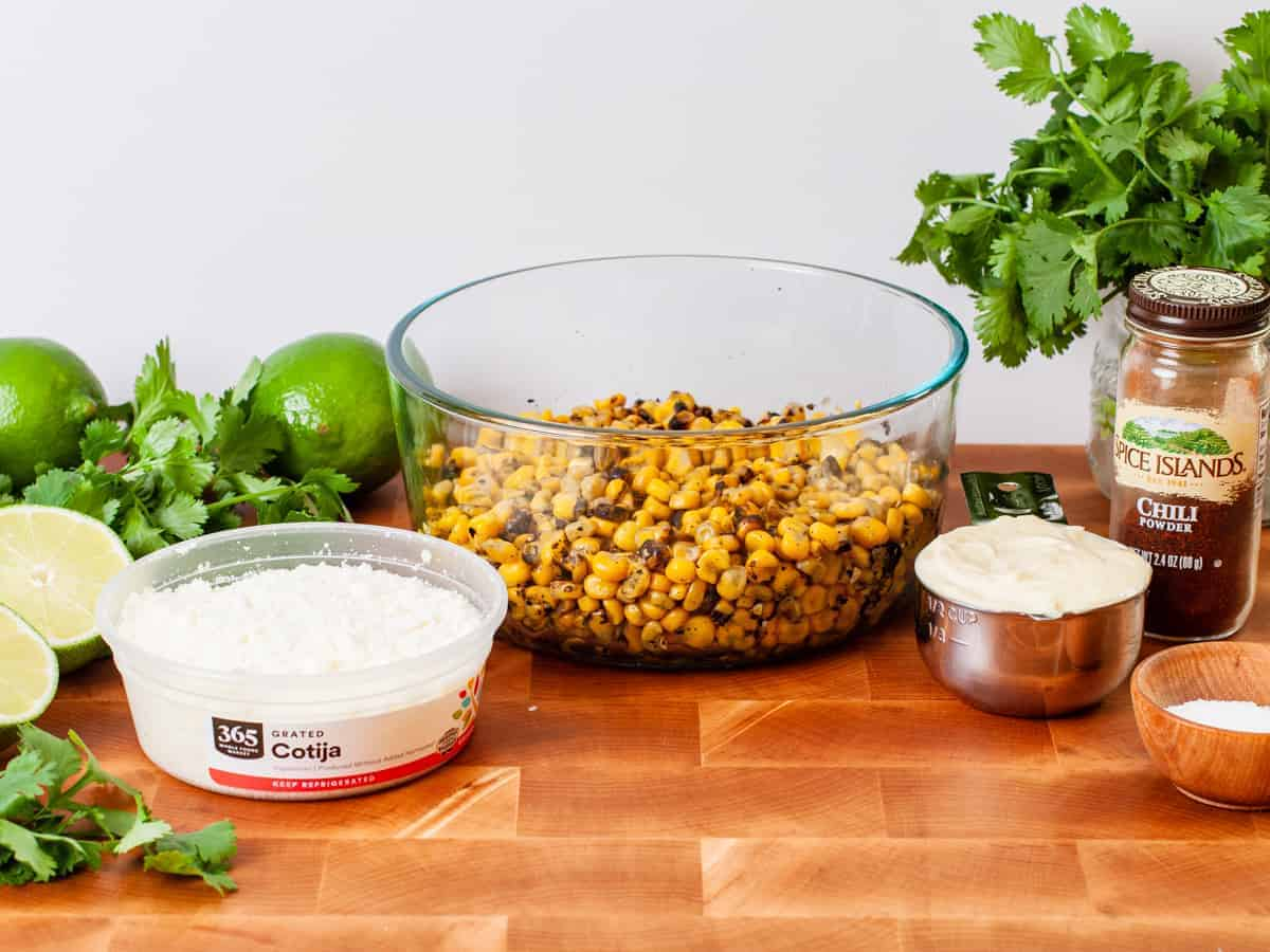 Ingredients for Mexican street corn salad arranged on counter