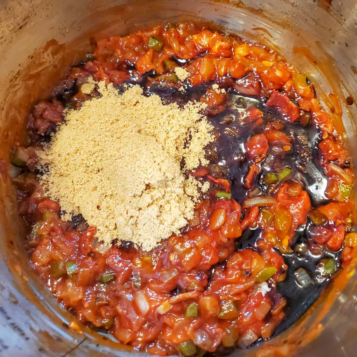 Cooked bacon and veggies in the Instant Pot with the ingredients for the sauce added and ready to stir in.