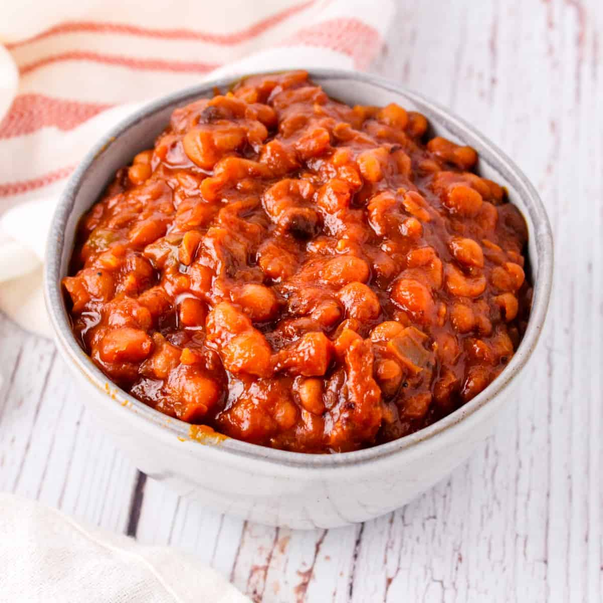Close up shot of finished beans served in a bowl.