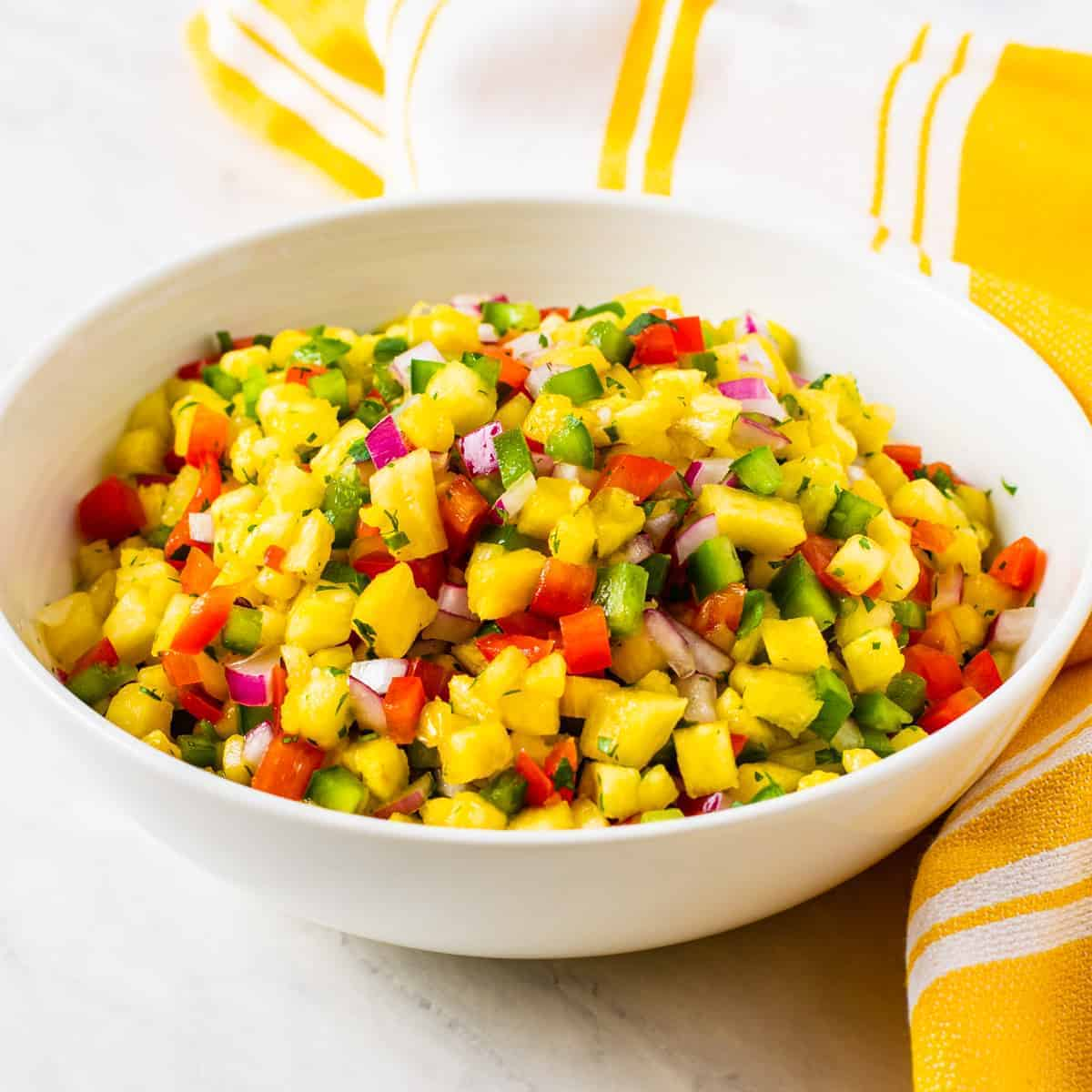 A bowl of fresh pineapple salsa