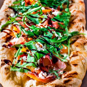 Close up view of the finished grilled peach pizza.
