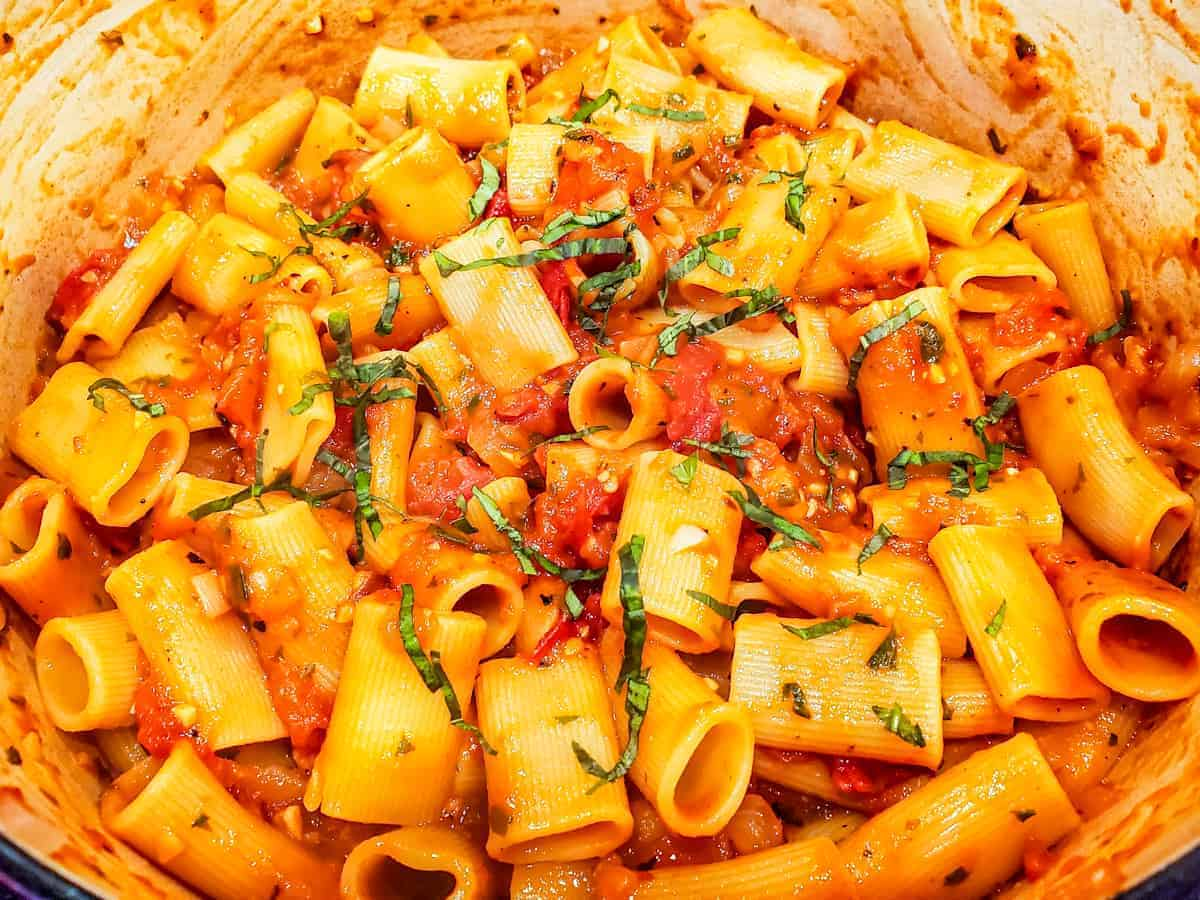 Image of the cooked pasta and sauce in a large dutch oven before serving.