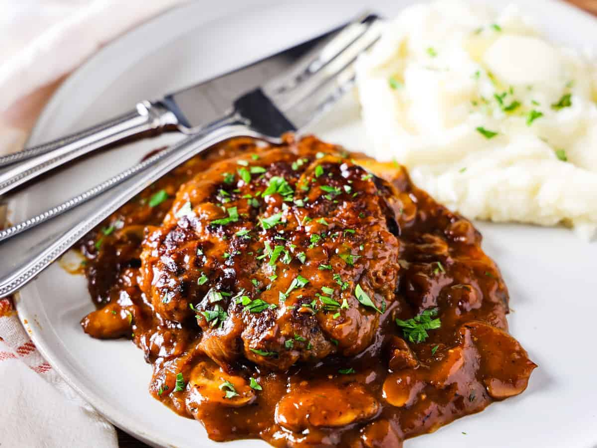 Image of the completed Salisbury steak and mushroom gravy served with homemade mashed potatoes.