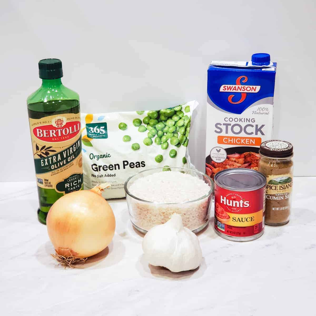 Assortment of ingredients for Instant Pot Spanish rice shown on a counter.