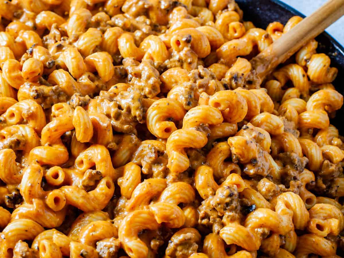 Close up shot of the finished cheesy pasta with ground beef.