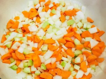 The vegetables are shown being sauteed in a dutch oven until tender.