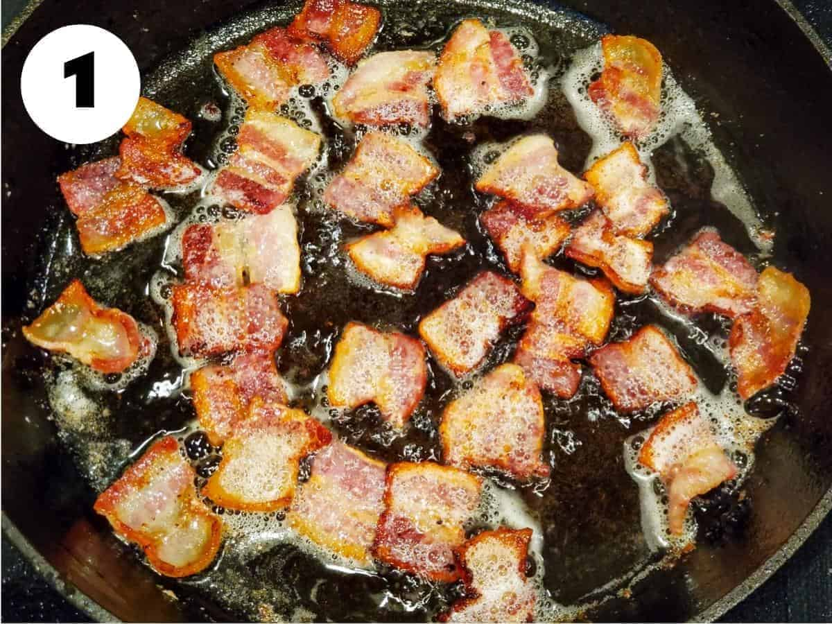 Bacon cooking in a cast iron skillet.