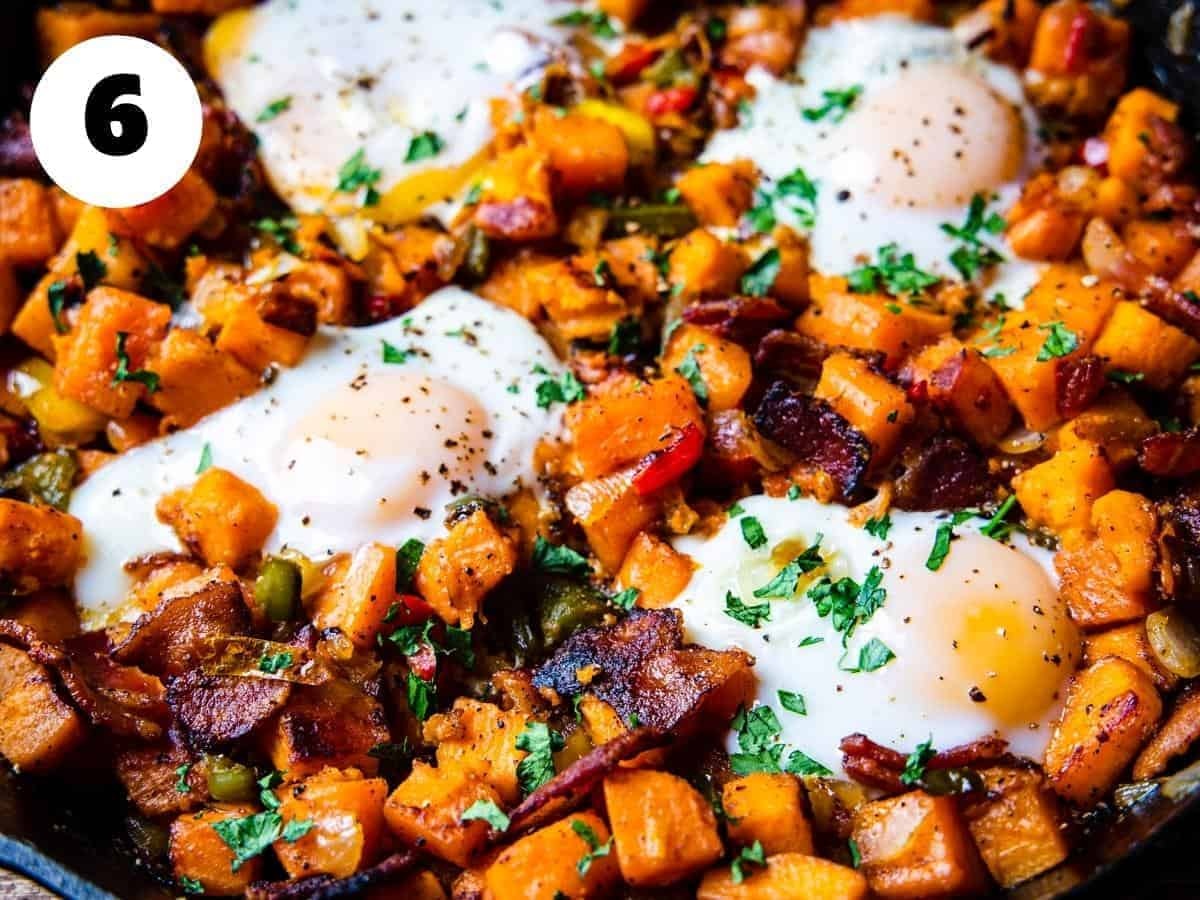 The finished sweet potato breakfast skillet is shown garnished with fresh chopped parsley.