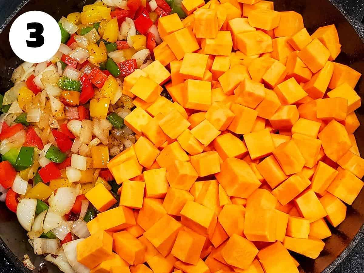 Diced sweet potatoes added to the skillet with onions and peppers.