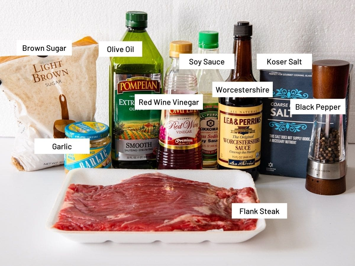 Ingredients for grilled flank steak shown on a counter.
