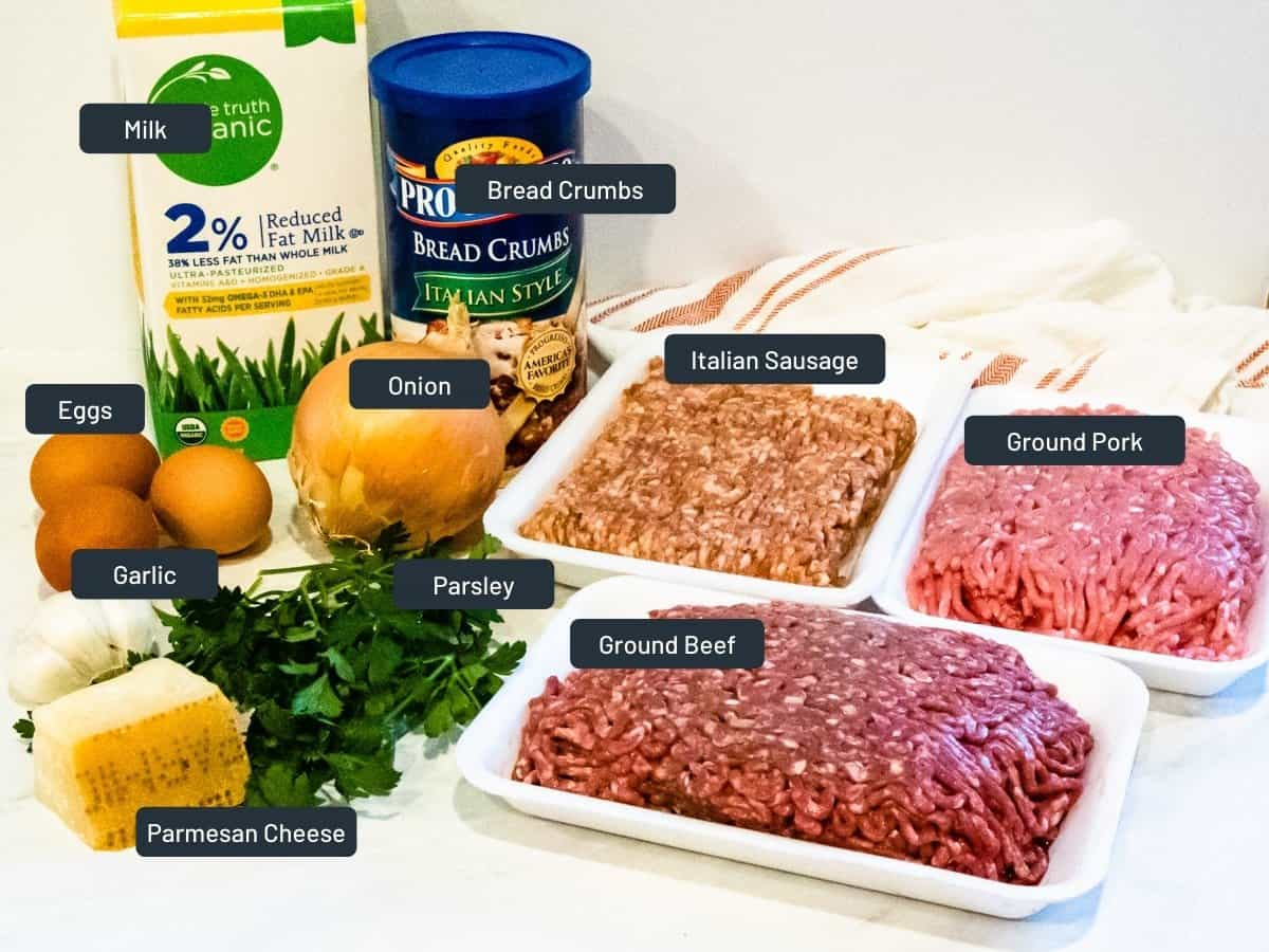 Ingredients for meatballs shown set on a counter.