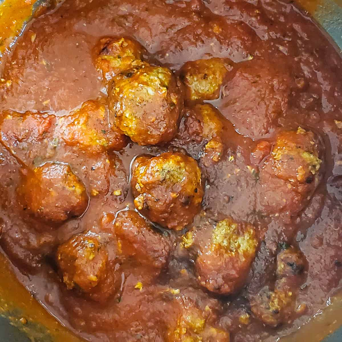 Meatballs and sauce shown in an Instant Pot after pressure cooking.