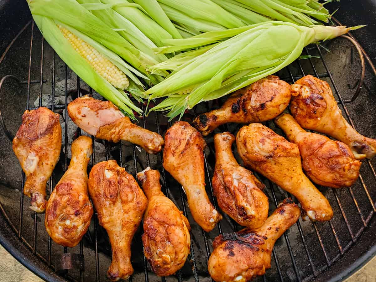 Chicken legs being cooked on a grill.
