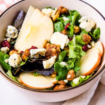 Close up view of a serving of fall apple walnut salad.